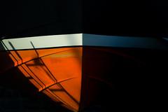 Dry Dock (Dex Horton Photography) Tags: minimalist minimal orange boat fishingboat dock repairs paintjob contrast evening essenceofbellingham dexhorton 2017 washingtonstate