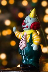 Bokeh Clown (~Arles) Tags: bokeh clown ornament christmas decoration indoors table lights christmaslights red yellow orange blur depthoffield