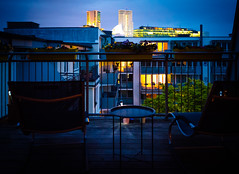 Evening in Berlin (Sergey Galyonkin) Tags: berlin chair chairs city couch couches germany light lights night rocking spring table terrace view