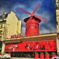 Paris  France  ~  Moulin Rouge  ~  Historic Building ~ Birth of Can - Can (Onasill ~ Bill Badzo) Tags: pars france moulin rouge monument cancan dance downtown french cabaret historic attraction mustsee attractionsite building windmill onasill tourist travel vacation red mill olympia original organic phonegraphy house europe ontmartre paris district pigalle boulevard de clichy cancandance birth metro station roof seductive entertainment club decor romance sky blue clouds concert nightclub