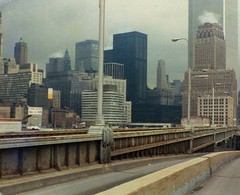 Exploring the abandoned West Side Highway on a gray day with an impending thunderstorm. Lower Manhattan, NY Telephone Company and the World Trade Center.  Many of the 19th century buildings on West Street had recently been demolished. New York. April 1974 (wavz13) Tags: oldphotographs oldphotos 1970sphotographs 1970sphotos oldphotography 1970sphotography vintagephotographs vintagephotos vintagephotography filmphotos filmphotography newyorkphotographs newyorkphotos oldnewyorkphotography oldnewyorkphotos vintagenewyork vintagemanhattan vintagenewyorkphotography vintagenewyorkphotographs vintagenewyorkphotos oldworldtradecenter vintageworldtradecenter twintowers originalworldtradecenter vintagetribeca oldtribeca lowerwestside vintageconstruction oldconstruction dreary rainy secretplaces hiddenplaces forgottenplaces urbanphotography urbanphotos urbanscenes cityphotography cityphotos manhattanskyline newyorkskyline newyorkskyscapers manhattanhistory newyorkhistory 1970smanhattan 1970snewyork oldnewyork oldmanhattan 1970shighways 1970shighway oldhighways abandonedhighways hudsonriver gloomy urban grain grainy abandonedroads