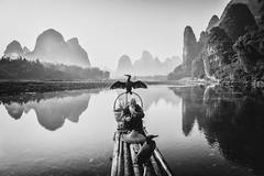 An Eternal Sunset (II) (Anna Kwa) Tags: sunset moment liriver yangshuo xingpingancienttown karstmountains reflections guilin china annakwa nikon d750 afsnikkor24120mmf4gedvr my eternalsunset always cormorantfisherman cormorants seeing heart soul throughmylens travel lost world destiny longing nostalgia desire regret dissatisfaction painful consciousness wmh