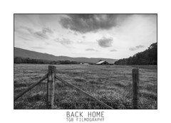 Back Home (TGB Filmography) Tags: landscape photography home backroads bw countryside flower fence barn backintime mountainside clouds blackandwhite mono sonya77ii tamron1024mm slowshutter longexposure