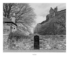 The Door (Rory Prior) Tags: bronica etrs edinburgh ilfordfp4plus scotland castle door doorway film mediumformat wall city street trees spring