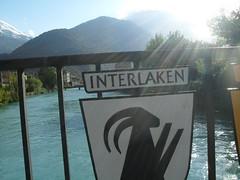 Interlaken (2009) (alexismarija) Tags: switzerland interlaken europe river mountains bridge water sign bernesehighlands alps swissalps thealps