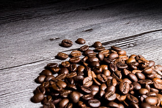 coffee grains on grunge wooden table