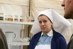 Faces of Vimy Ridge 100: Glance of a nurse (Can Pac Swire (away for a bit)) Tags: toronto ontario canada canadian forces armed army fortyork national historic site reenactment worldwar one 1 i wwi great war 1917 battle vimyridge 2017 100th 100 anniversary centenary remembrance 2017aimg7937 nurse