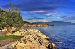 Neve di Primavera (giannipiras555) Tags: montagna neve colori azzurro nuvole paesaggio landscape panorama alberi lago garda