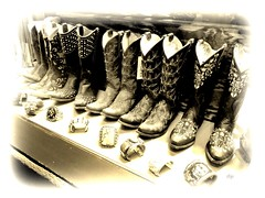 boots and bracelets ~ sepiatone (milomingo) Tags: boot leather western southwestern cowboy cowboyboot footwear fancy bracelet art jewelry silver nativeamercian shop shopping retail merchandise display angle texture santafe newmexico nightshot monochrome sepia photoborder sepiaimpressions cmwd cmwdblackandwhite