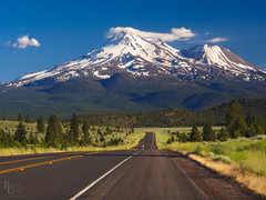 The Road to the Mountain (RobertCross1 (off and on)) Tags: 1250mmf3563mzuiko ca california cascaderange cascades em5 mountshasta mtshasta omd olympus shastina siskiyou volcaniclegacyscenichighway bluesky clouds forest grassland highway landscape mountain road snow street trees volcano