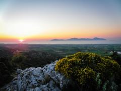 As the Sun Begins to Set (Tassos Giannouris) Tags: sun sunset set greece kos greek landscape island green orange sky rocks horizon olympus beautiful sea