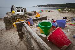 End Of Play (NVOXVII) Tags: beach toys buckets spades trucks playing children coast nikon sombre empty deserted haunting sand moody unnerving colour landscape shoreline wood studlandbay dusk