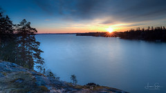 Sunrise at Sarvikallio (lsten) Tags: rock spring natureview calm amazing nature water bracketing lake tuusula theunforgettablepictures rays hdr tripod wideangle amateurphotography landscapephotography stunning sky view landscape 20mm cliffs trees tree sunrise morning clouds sunrays sun sarvikallio viewingpoint scenery beautiful peaceful iso400 canonef1635mmf4lisusm ray rocks bracketed finland golden canoneos5dmarkiv f14