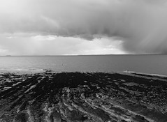 Bristol Channel storm (Hammerhead27) Tags: water rain dark clevedon beach bw blackandwhite mono bristolchannel storm sky cloud coast