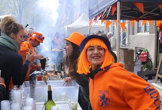 Smiling waitress at King's day