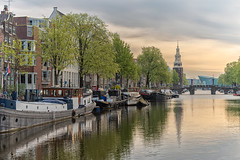 Amsterdam sunrise (angheloflores) Tags: amsterdam oudeschans canal houses city travel architecture urban explore colors netherlands nemo water reflections bridge clouds sky boat montelbaanstoren tower