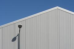 Street lamp in front of a grey building (on Explore) (Jan van der Wolf) Tags: map169195vv straatlantaarn streetlight streetlamp schaduw shadow lines lijnen simple simpel minimalism minimalistic composition compositie grey grijs building gebouw facade geometric