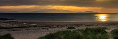 Arran Through the Mist (Brian Travelling) Tags: arran isleofarran firthofclyde irishsea ayrshire ayrshirenorth northayrshire riverclyde dunes grass beach westkilbride seamill pentaxkr pentax pentaxdal peaceful peace tranquil sunset golden water sky blue