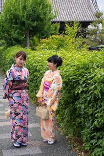 Young women in kimono walking in Kyoto traditional district