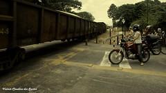 Railroad crossing (VCLS) Tags: vcls trem train ferrovia railroad passagem moto motocicleta motorcycle motoneta motorcycles mulher womanonscooter woman valmir valmirclaudinodossantos brasil brazil scooter scootering scootergirl scooterist motociclismo motocilista girlonmotorcycle cidade city cityscape people pessoas rua street candid