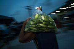 * (Sakulchai Sikitikul) Tags: street snap streetphotography songkhla sony a7s voigtlander 28mm flash thailand hatyai worker cucumber