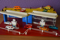 1970's Matchbox Cars at the National Garage. (EYBusman) Tags: matchbox cars toys ford cortina land rover fire truck cadillac ambulance national petrol benzene gas gasoline filling service station garage mustang mercedes benz eybusman zodiac vw camper
