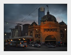 station bokeh (Andrew C Wallace) Tags: city cbd flindersstreetstation melbourne victoria australia microfourthirds m43 olympusomdem5 tiltshift dusk evening bokeh shallowdof trams clocks bmw eurekatower