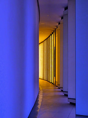 Lower Level, Louis Vuitton Foundation, Paris, France (duaneschermerhorn) Tags: architecture architect gehry frankgehry reflection pillars modern contemporary modernarchitecture contemporaryarchitecture gold yellow blue mirrors curve hallway passage corridor