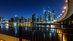 Dubai View ... (Wissam Shehade) Tags: sky reflections sunset downtown blue buildings clouds architecture towers lights skyline skyscraper longexposure calmness cityscapes burjkhalifa bluehour waterscapes dubai uae mydubai