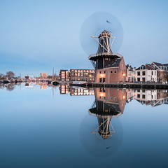 Evening spin (McQuaide Photography) Tags: haarlem noordholland northholland netherlands nederland holland dutch europe sony a7rii ilce7rm2 alpha mirrorless 1635mm sonyzeiss zeiss variotessar fullframe mcquaidephotography adobe photoshop lightroom tripod manfrotto light licht availablelight dusk twilight schemering bluehour water reflection longexposure stad city urban river spaarne rivier waterside outdoor outside waterfront architecture skyline building gebouw wideangle wideanglelens groothoek windmill molen molendeadriaan scheepmakerskwartier calm peaceful tranquil landmark adriaan square 11 motion blur movement spin spinning