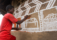 Young man painting the wall of a traditional ethiopian house, Kembata, Alaba Kuito, Ethiopia (Eric Lafforgue) Tags: abyssinia adolescent africa african alaba architecture art artist building color culture day decorated decoration depiction eastafrica ethiopia ethiopian ethnic geometric home horizontal hornofafrica house housing hut illustration kulito mural naive oneperson outdoors painted painter painting people poverty skill teenager toukoul tukul village work working youngadult ethio163436 alabakuito kembata