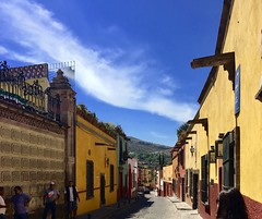streets of SMDA (Rnoltenius) Tags: san miguelde allende streets colors quaint old cobblestones walls sun mountain blue skies clouds whisps