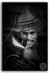 The amused Mellophone player in the Kalash Yatra! (FotographyKS!) Tags: mellophone man portrait blackandwhite bw music streetphotography jaipur closeup trumpet band cabaret adult artist profession background blow blues bow brass kalashyatra rajasthan trombones character classic classical happy eyes horn instrument male musical musician occupation perform performer person play player retro rhythm studio style suit trumpeter urban saxophone jazz elegant festival flute holding isolated orchestra symphony young portraitunlimited