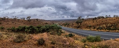 The road to Menindee (Ralph Green) Tags: australia brokenhill menindee newsouthwales clouds grasses panorama road rocks trees