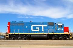 GTW 4934 (dangaken) Tags: grandtrunkwestern gtw grandtrunkrailroad rail train locomotive railway railroad 4934 flint flintmi michigan mi emd emdgp382 gp gp382 exmopac missouripacific mopac bishopairport mp7344 cn canadiannational bluesky summer spring gtw4934