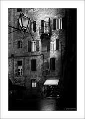 Corner shop (G. Postlethwaite esq.) Tags: bw chianti italy siena sonya7mkii sonyalphadslr tuscany awning blackandwhite building corner fullframe lamp mirrorless monochrome photoborder shop shutters windows emount thedailypost