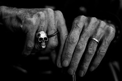 A pact with your wife ... and the devil (Hans Dethmers) Tags: hand hands handen ring weddingring trouwring duivel devil deadhead doodshoofd lowkey zwartwit blackandwhite monochrome fuji