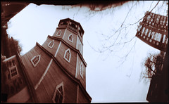 Leaning Tower (batuda) Tags: pinhole obscura stenope lochkamera analog analogue can coffee coffeecan cylindrical elliptical anamorph anamorphic film paper ortho orthochromatic photocopy d76 color colour toned wide wideangle distortion architecture building tower wooden church house block tree trees branches town radviliškis lithuania lietuva wppd 9x12