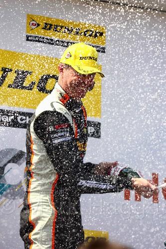 Matt Neal celebrates his BTCC win on the podium at Thruxton, May 2017