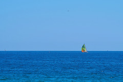 Sailing in bright colors (Fnikos) Tags: sky skyline colors water sea seascape sailing boat sailboat serene vehicle outdoor