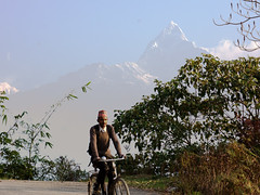 Cycling down the road in front of Fishtail mountain, Sarangkot, Nepal (suebunnybungard) Tags: landscape nepal sarangkot fishtail mountain