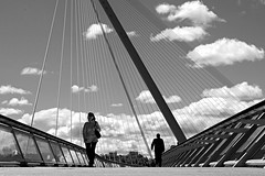 Across the bridge (Daniel Nebreda Lucea) Tags: bridge puente architecture arquitectura black white blanco negro people gente city ciudad sky cielo clouds nubes sun sol sunny soleado cloudy nublado walking andando two dos monochrome monocromo zaragoza europe europa spain españa canon 50mm 60d urban urbano life vida point view punto vista perspective perspectiva composition composicion nwn structure estructura nature naturaleza woman mujer shadows sombras light luz