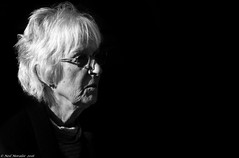 See Me. (Neil. Moralee) Tags: neilmoralee neilmoraleenikond7100 old mature woman lady glasses wrinkle wrinkles blonde blond gray black white blackandwhite neil moralee nikon d7100 face portrait blackbackground dark sunlight shadow close mother grandmother granny gran poem crabby wise infirm crotchety angry alone sad lost denentia alzheimers dementia brain mind mindless forget forgetful memmory loss scared frightened fear retirement retired nursing home nurse love loving daughter wife friend grey housewife matriache bandw bw