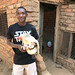 Konga farmer proudly holding one of his chickens