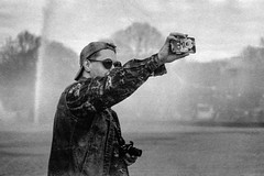 «Against the background of the fountain» (Andrey  B. Barhatov) Tags: moskva moscow russia ru moscowwalks mood 2017 analoguephotography analogphoto analog film filmtype135 filmfilmforever filmphoto filmphotography filmisnotdead filmoriginal filmmood lomography yuryyakovenko portrait streetportrait streetphoto svema svema64 oldfilm russianfilm sovietfilm expiredfilm overduefilm grain grunge oldcamera pentaxmz7 pentaxart smcpentaxfa80320mmf4556 pentaxfa80320mm pentax gorkypark russianphotolook russianfederation street blackandwhiteonly bnwmood blackandwhite artinbw bwfp bnwfilm bnwdark bnw bw cityandpeople people face faces park monochrome monotone россия москва люди лица паркгорького весна фотопленка стараяфотопленка пленка просрочка свема свема64 чернобелое fountain photographer epsonstylusphotorx500 smcpfa80320mmf456