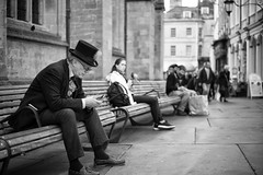 Mobile Hatter (Foto John) Tags: leicam leicam240 leica leicamtyp240 rangefinder summicronm50mmƒ2iv blackwhite blackandwhite blackandwhitethatsright monochrome streetphotography people man woman tophat etcentric bath uk zwartwit