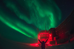 Aurora Hero Shot (redfurwolf) Tags: southpole southpolestation auroraaustralis aurora antarctica sky snow ice station outdoor nature redfurwolf sonyalpha sony building person hero ngc