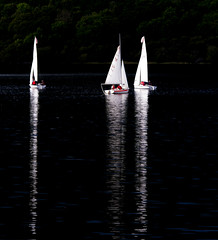 On darker tides (kathharper23) Tags: sailing dark water reflections light boats