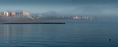 Besieged by dawn... (Francizc Chachula) Tags: nikon d7200 70300mm sunrise march 2017 constanta romania morning cityscape beach sea blacksea water fog panorama