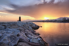 Lighthouse, Staring At The Sunset :: HDR :: DRI (servalpe) Tags: highpass hdr stones rocas servalpe topazadjust hitech photomatix atardecer lighthouse sunset sigma reflections harbor sigma1020mm canon faro nd8 shore canoneos450d nd marbella reflejos neutraldensity tonemapped filter noiseware beach 1020 longexposure seascape rocks 09 harbour clouds andalucía spain es